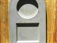 vibracrete tombstone with round and square pattern